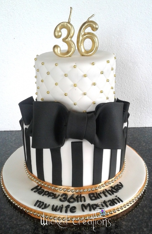 Gallery - Category: Cakes for Women - Image: Black, White & Gold Cake